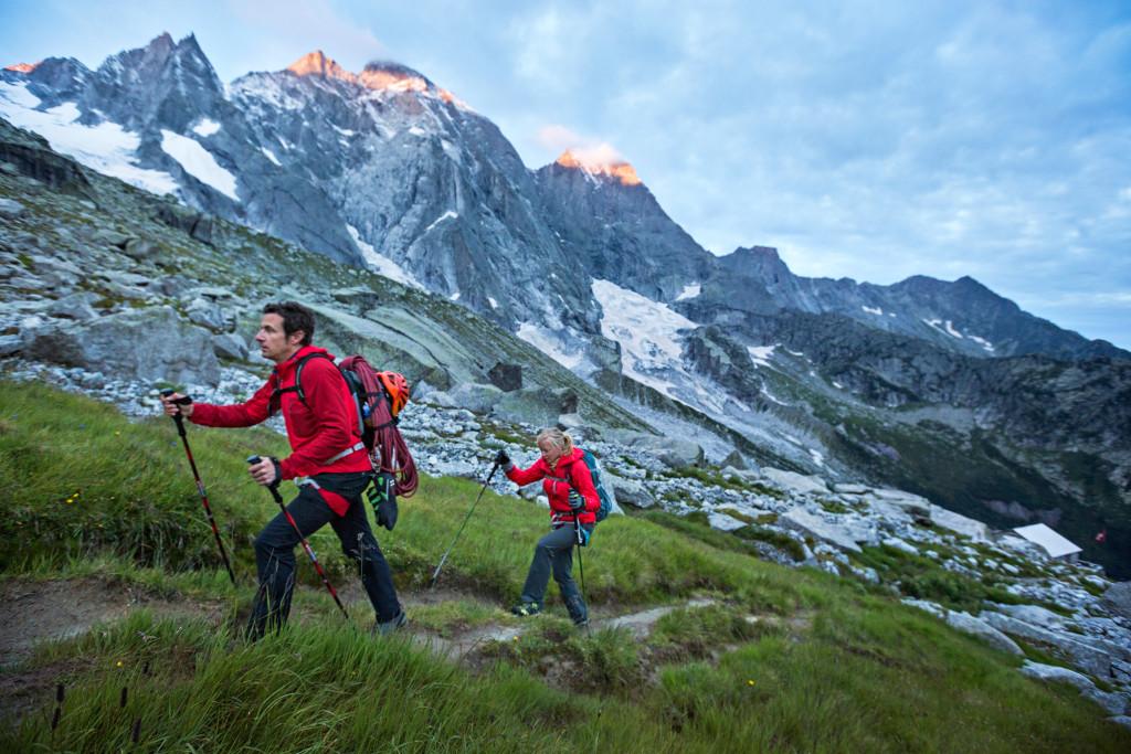 Climbers leaving the Sciora Hut at sunrise